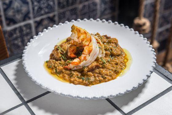 Shrimp porridge, soft hen egg, parsley, and chili peppers.