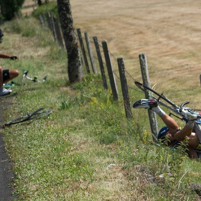 One of the breakaway men, Netherland's Johnny Hoogerland (R) is seen in the barbed-wire after he crashed at the side of the road with Spain's Juan Antonio Flecha (L) during the 208 km and ninth stage of the 2011 Tour de France cycling race run between Issoire and Saint-Flour, center rance, on July 10, 2011. Hoogerland and Hoogerland survived being hit at speed by a car which bore the marking of France Televisions. AFP PHOTO / LIONEL BONAVENTURE (Photo credit should read LIONEL BONAVENTURE/AFP/Getty Images)