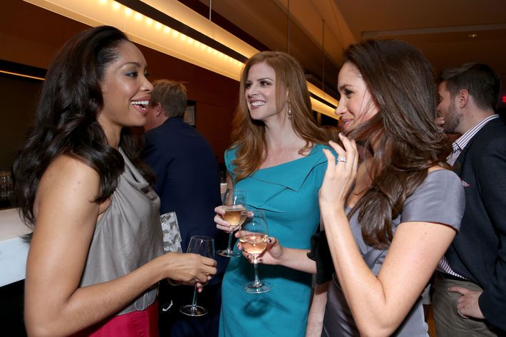 Suits stars Gina Torres, Sarah Rafferty, and Meghan Markle.