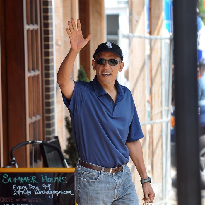 US President Barack Obama waves after shopping at Bunch of Grapes bookstore with his daughters Malia and Sasha in Vineyard Haven on Martha's Vineyard, Massachusetts, on August 20, 2010. The First Family is on vacation on the Island. AFP PHOTO/Jewel Samad (Photo credit should read JEWEL SAMAD/AFP/Getty Images)
