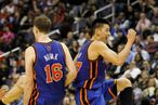 WASHINGTON, DC - FEBRUARY 08:  Jeremy Lin #17 of the New York Knicks and Steve Novak #16 celebrate during a timeout against the Washington Wizards during the second half at Verizon Center on February 8, 2012 in Washington, DC. NOTE TO USER: User expressly acknowledges and agrees that, by downloading and or using this photograph, User is consenting to the terms and conditions of the Getty Images License Agreement.  (Photo by Rob Carr/Getty Images)