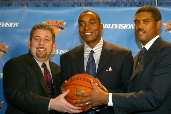 NEW YORK - DECEMBER 22:  (L-R) Cablevision chairman James Dolan, newly hired New York Knicks General Manager and Team Presedient Isiah Thomas and President of Madison Sqaure Garden Sports Steve Mills pose for a photo op following a press conference that announced the firing of Scott Layden as Knicks Team President and GM and the hiring of Thomas as his replacement on December 22, 2003 at Madison Square Garden in New York City.  NOTE TO USER: User expressly acknowledges that, by downloading and or using this photograph, User is consenting to the terms and conditions of the Getty Images License agreement.  (Photo by Ray Amati/NBAE via Getty Images)