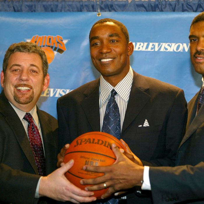 (L-R) Cablevision chairman James Dolan, newly hired New York Knicks General Manager and Team Presedient Isiah Thomas and President of Madison Sqaure Garden Sports Steve Mills pose for a photo op following a press conference that announced the firing of Scott Layden as Knicks Team President and GM and the hiring of Thomas as his replacement on December 22, 2003 at Madison Square Garden in New York City.