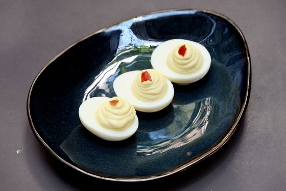 Deviled eggs with Sriracha flakes.