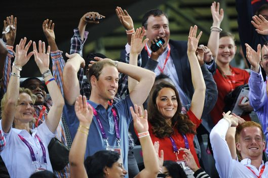 LONDON, UNITED KINGDOM - AUGUST 30:  Prince William, Duke of Cambridge and Catherine, Duchess of Cambridge (R) take part in a Mexican wave as they watch the cycling in the Velodrome during Day 1 of the London 2012 Paralympic Games on August 30, 2012 in London, England.  (Photo by Stefan Rousseau - WPA Pool/Getty Images)