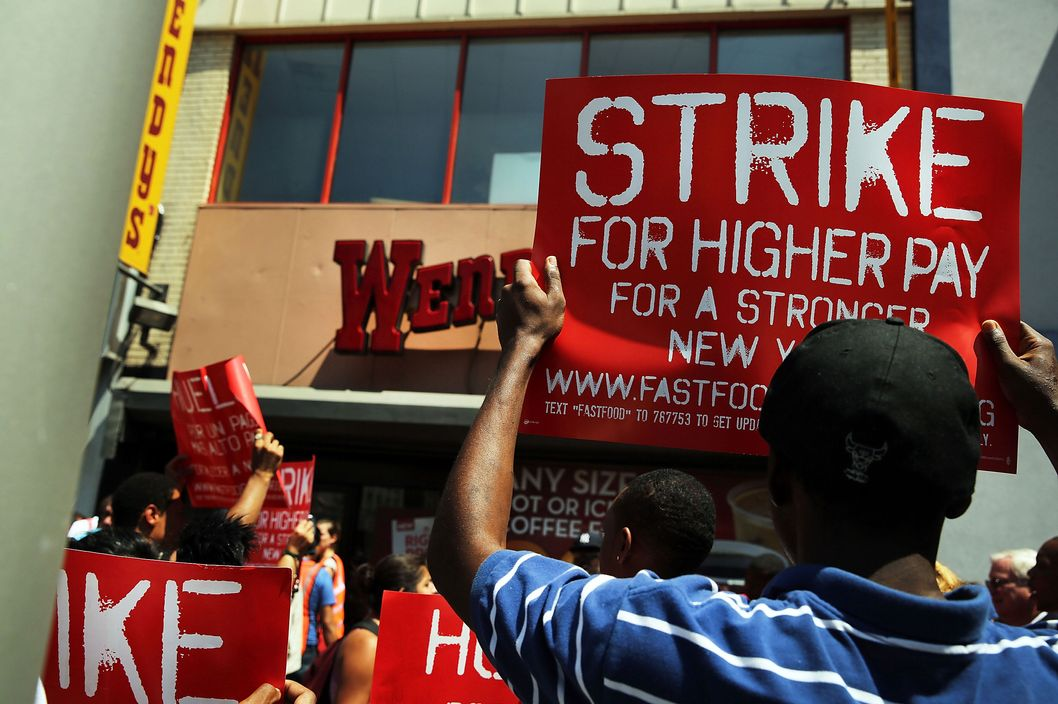 Employees and supporters demonstrate outside of a Wendy's fast-food restaurant to demand higher pay and the right to form a union on July 29, 2013 in New York City.  Across the country thousands of low-wage workers are expected to walk off their jobs Monday at fast food establishments in seven U.S. cities. Workers at KFC, Wendy's, Burger King, McDonald's and other restaurants are calling for a living wage of $15 an hour and the right to form a union without retaliation.