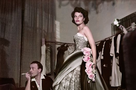 Robert Capa, [Actress Geraldine Brooks trying on a dress at the fashion house of Emilio Schuberth, Rome], August 1951. ? Robert Capa/International Center of Photography/Magnum Photos.