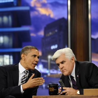 """US President Barack Obama(L) during an interview on the """"Tonight Show with Jay Leno"""" at the NBC Studios in Burbank, California, on October 25, 2011. Obama unveiled a stopgap plan Monday to ease the bite of the real estate crisis for cash-strapped homeowners while attacking Congress for blocking spending to create more jobs. Thwarted by Republican opposition to his bigger jobs and stimulus package, Obama has shifted tactics by looking for action he can take without congressional approval to provide at least modest economic relief. AFP Photo/Jewel Samad (Photo credit should read JEWEL SAMAD/AFP/Getty Images)"""