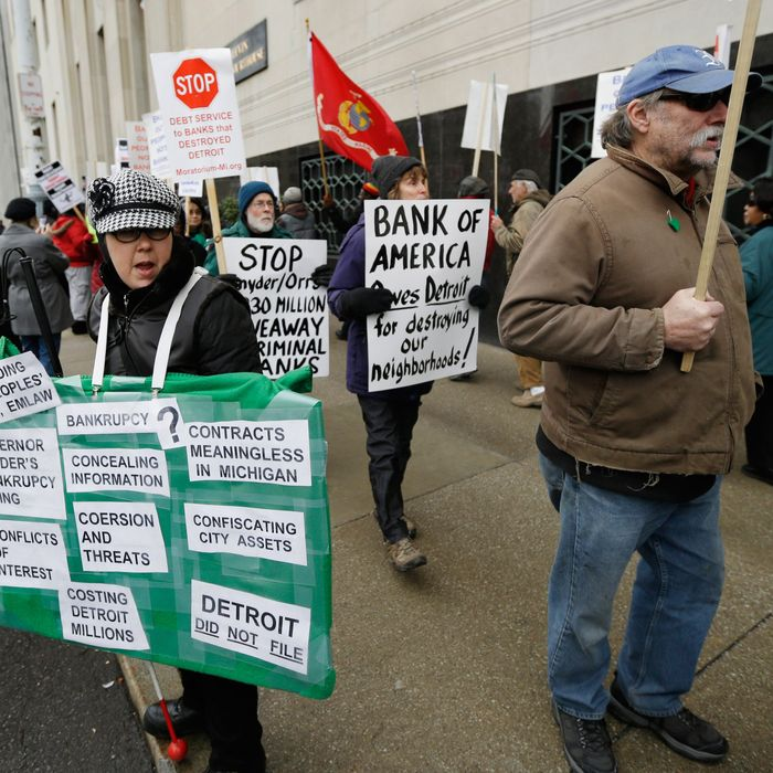 Detroit city workers and supporters protest outside the federal courthouse in Detroit while awaiting the bankruptcy decision, Tuesday, Dec. 3, 2013. A judge is expected to announce Tuesday if the city is to become the biggest city in U.S. history to enter bankruptcy.