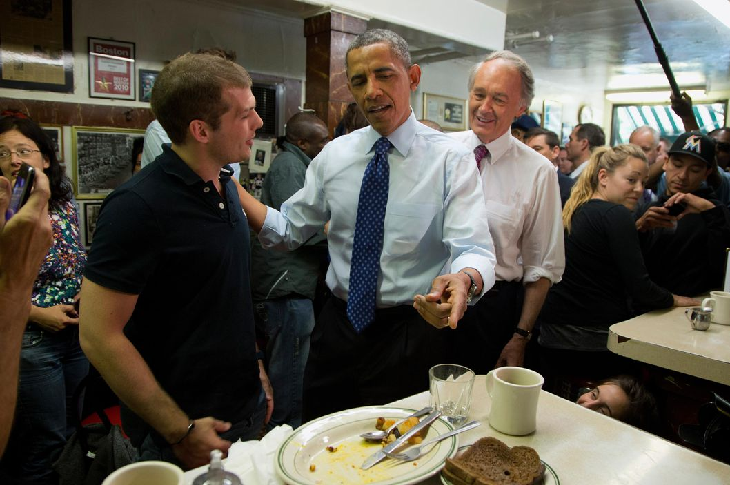 President Barack Obama, accompanied by Democratic Massachusetts Senate candidate, Rep. Ed Markey, right, talk with patrons at Charlie's Sandwich Shoppe in Boston, Wednesday, June 12, 2013. Obama traveled to Boston to campaign for Markey in his campaign.