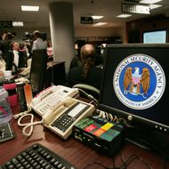 Fort Meade, UNITED STATES:  A computer workstation bears the National Security Agency (NSA) logo inside the Threat Operations Center inside the Washington suburb of Fort Meade, Maryland, intelligence gathering operation 25 January 2006 after US President George W. Bush delivered a speech behind closed doors and met with employees in advance of Senate hearings on the much-criticized domestic surveillance.