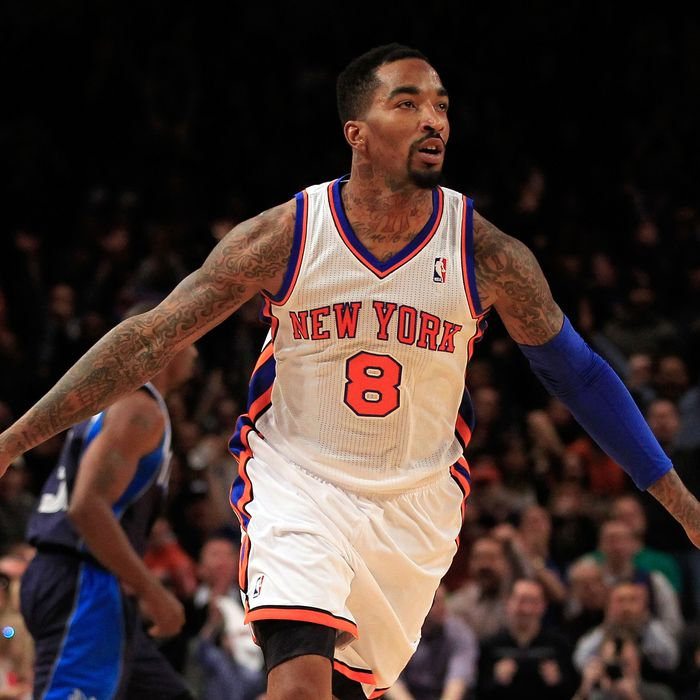 J.R. Smith #8 of the New York Knicks celebrates scoring a three pointer against the Dallas Mavericks at Madison Square Garden on February 19, 2012 in New York City.