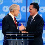 LAS VEGAS, NV - OCTOBER 18: U.S. Rep. Ron Paul (R-TX) (L) and former Massachusetts Gov. Mitt Romney shake hands after the Republican presidential debate airing on CNN, October 18, 2011 in Las Vegas, Nevada. Seven GOP contenders are taking part in the debate, which is sponsored by the Western Republican Leadership Conference in Las Vegas and held in the Venetian Hotel's Sands Expo and Convention Center. (Photo by Ethan Miller/Getty Images)
