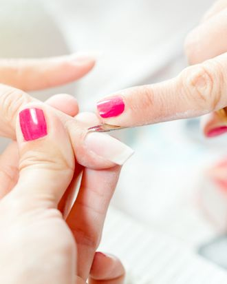 Hmm, it appears that the manicurist has cooler nails than the customer in this picture.