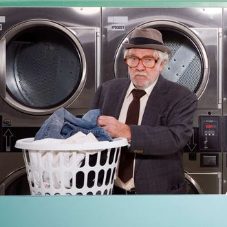 Middle Aged Man in Laundromat.