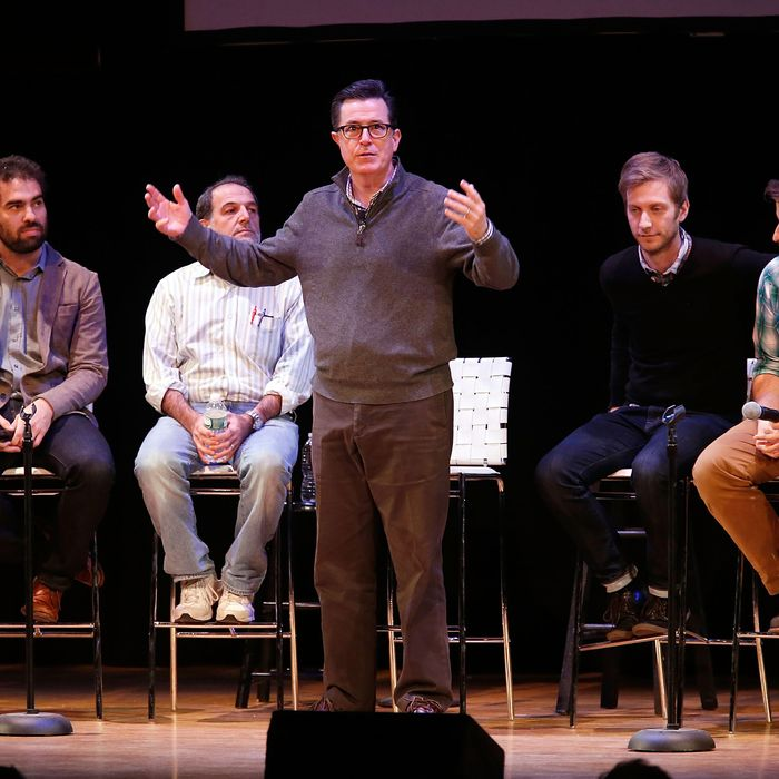 NEW YORK, NY - NOVEMBER 07: Comedian/media personality Stephen Colbert speaks on stage with a panel of writers from the
