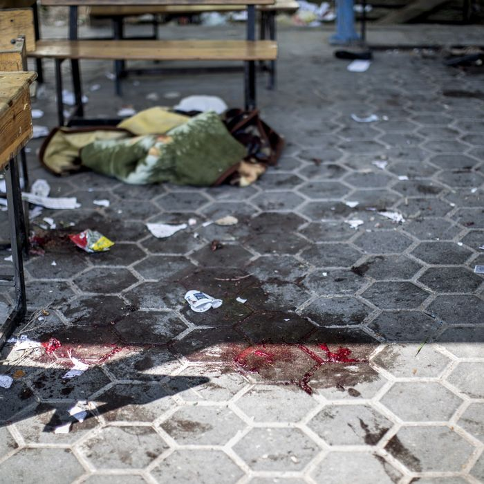 A trail of blood is seen in the courtyard of a UN School in the northern Beit Hanun district of the Gaza Strip on July 24, 2014, after it was hit by an Israeli tank shell. At least nine people were killed, including a baby, when an Israeli tank shell slammed into a UN-run school in the northern Gaza Strip, an AFP correspondent said.