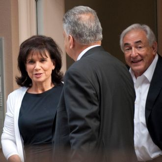 Dominique Strauss-Kahn (R) and his wife Ann Sinclair exit their townhouse July 1, 2011 in New York. Former IMF chief Dominique Strauss-Kahn was freed from house arrest Friday after prosecutors raised serious doubts about the credibility of the woman accusing him of sexual assault. The sensational twist raised French opposition hopes that the sexual assault case will collapse and the Socialist party favorite will return to frontline politics, possibly even as a candidate to fight Nicolas Sarkozy for the presidency in 2012. AFP PHOTO / DON EMMERT (Photo credit should read DON EMMERT/AFP/Getty Images)