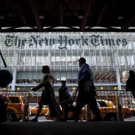 Pedestrians pass in front of the New York Times Co. building in New York, U.S., on Wednesday, April 27, 2011. New York Times Co., publisher of the namesake newspaper, said more than 100,000 people signed up for new digital subscriptions, a sign online revenue may help offset a decline in print advertising and circulation. Photographer: Michael Nagle/Bloomberg via Getty Images
