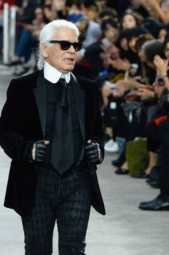 Fashion designer Karl Lagerfeld acknowledges applause following the  Chanel show as part of the Paris Fashion Week Womenswear  Spring/Summer 2014 at Grand Palais on October 1, 2013 in Paris, France.