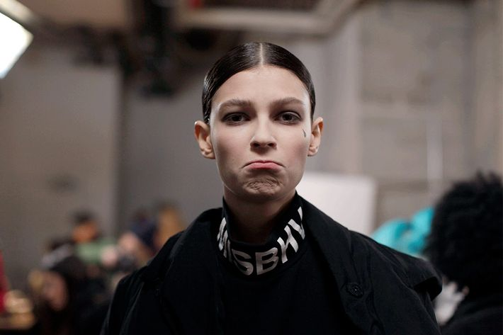 A model pouts at Thom Browne.