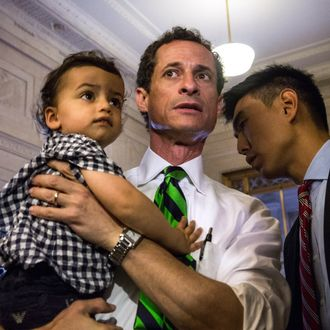 NEW YORK, NY - SEPTEMBER 10: New York City mayoral hopeful Anthony Weiner (C) arrives at his polling station his son, Jordan Weiner, to vote in the Democratic primary on September 10, 2013 in New York City. Weiner ran into a minor issue while voting this morning: a required signature proving he was Anthony Weiner was not on file at the local polling station. The problem was soon solved by the Board of Elections. (Photo by Andrew Burton/Getty Images)