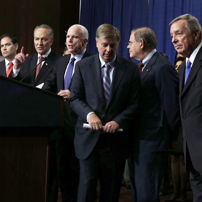 (L-R) U.S. Sen. Jeff Flake (R-AZ), Sen. Marco Rubio (R-FL), Sen. Charles Schumer (D-NY), Sen. John McCain (R-AZ), Sen. Lindsey Graham (R-SC), Sen. Bob Menendez (D-NJ), Sen. Richard Durbin (D-IL), and Sen. Michael Bennet (D-CO), also known as the Gang of Eight, speak to members of the media during a news conference on immigration reform April 18, 2013 on Capitol Hill in Washington, DC. The senators discussed the