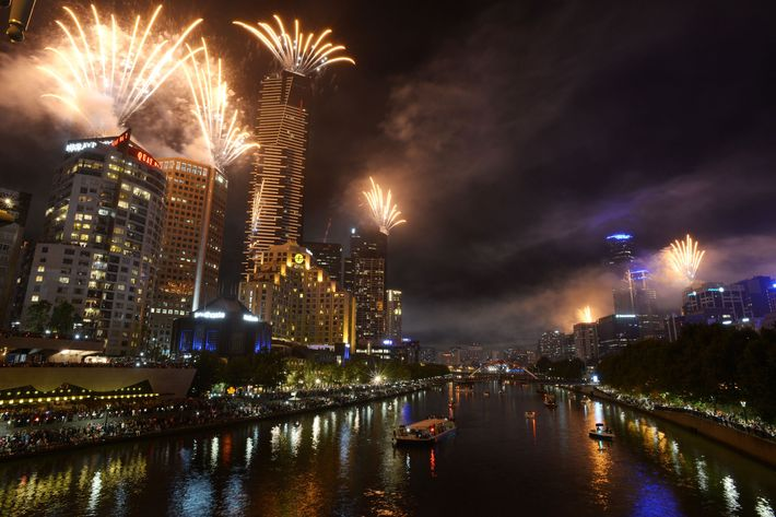 Fireworks over Melbourne skyline and Yarra River during New Years Eve fireworks on December 31, 2013 in Melbourne, Australia.