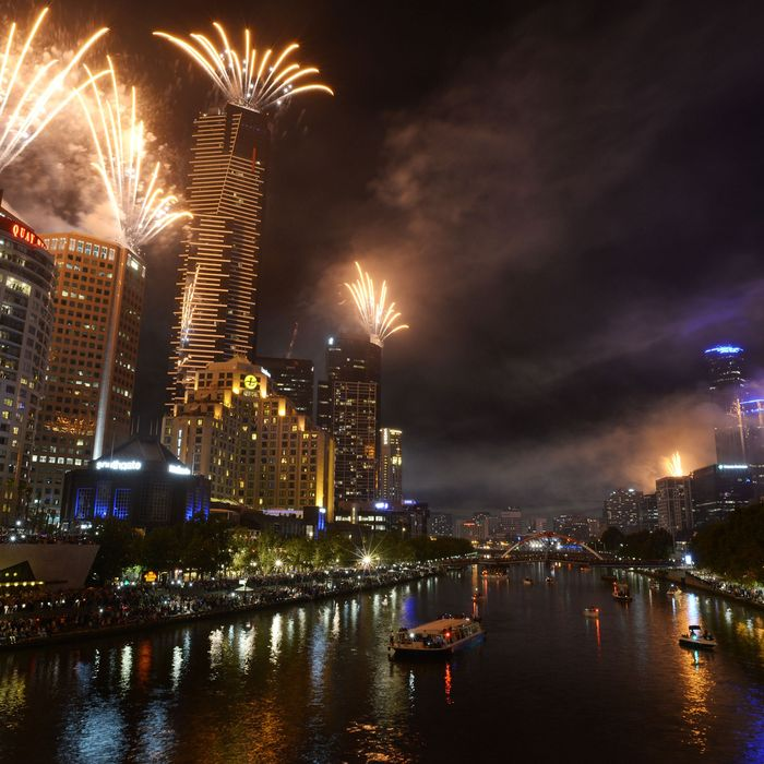 Fireworks over Melbourne skyline and Yarra River during New Years Eve fireworks on December 31, 2013 in Melbourne, Australia.