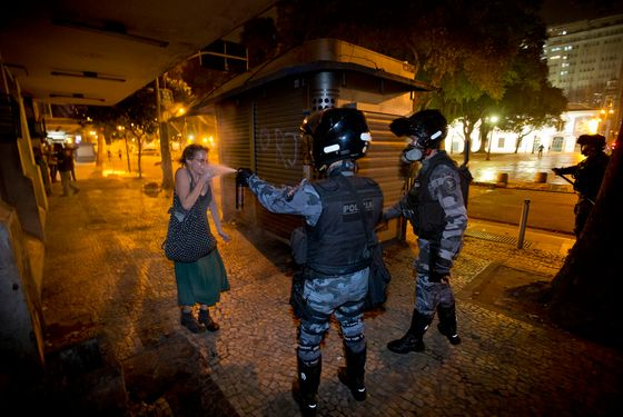 A military police peper sprays a protester during a demonstration aga in Rio de Janeiro, Brazil, Monday, June 17, 2013. (AP Photo/Victor R. Caivano)