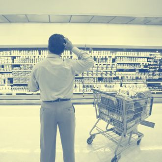 Man Standing in Grocery Store Aisle.