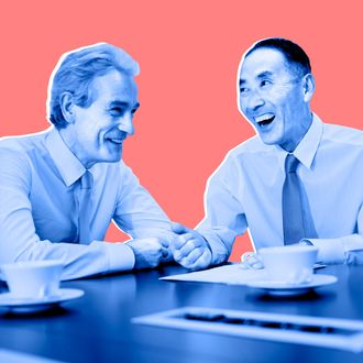 Businessmen laughing in meeting