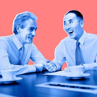 Businessmen laughing in meeting