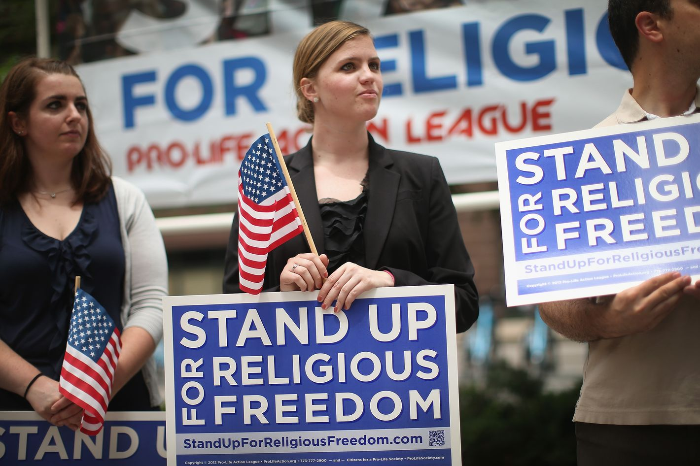 CHICAGO, IL - JUNE 30:  Religious freedom supporters hold a rally to praise the Supreme Court's decision in the Hobby Lobby, contraception coverage requirement case on June 30, 2014 in Chicago, Illinois. Oklahoma-based Hobby Lobby, which operates a chain of arts-and-craft stores, challenged the provision and the high court ruled 5-4 that requiring family-owned corporations to pay for insurance coverage for contraception under the Affordable Care Act violated a federal law protecting religious freedom.    (Photo by Scott Olson/Getty Images)