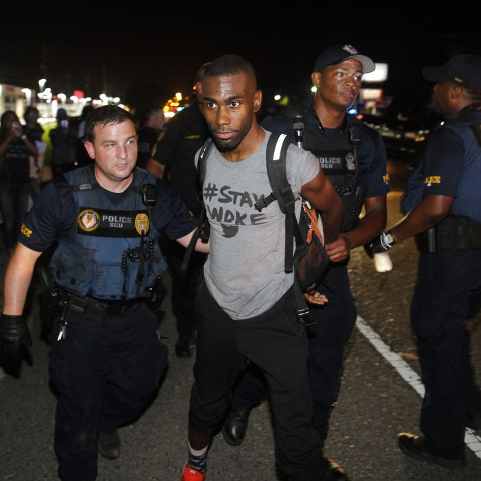 Police arrest activist DeRay McKesson during a protest along Airline Highway, a major road that passes in front of the Baton Rouge Police Department headquarters Saturday, July 9, 2016, in Baton Rouge, La. Protesters angry over the fatal shooting of Alton Sterling by two white Baton Rouge police officers rallied Saturday at the convenience store where he was shot, in front of the city's police department and at the state Capitol for another day of demonstrations. (AP Photo/Max Becherer)