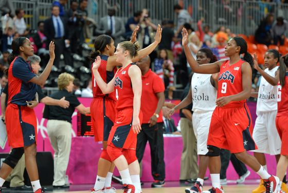 US players celebrate at the end of the Women's preliminary round group A basketball match of the London 2012 Olympic Games Angola vs USA on July 30, 2012 at the basketball arena in London. USA won 90 to 38.       AFP PHOTO / MARK RALSTON        (Photo credit should read MARK RALSTON/AFP/GettyImages)