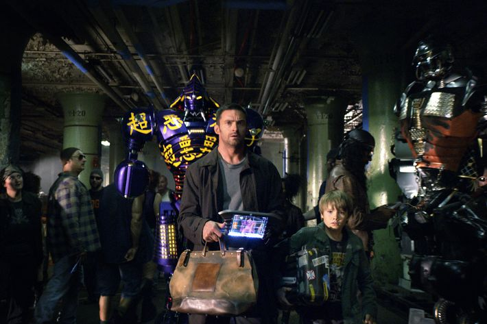 """""""REAL STEEL""""  RS-FF-006  Down-on-his-luck fight promoter Charlie Kenton (Hugh Jackman, left) and his son, Max (Dakota Goyo, right) enter their star robot boxer Noisy Boy in a match at the Crash Palace in DreamWorks Pictures' action drama """"Real Steel"""".  ?DreamWorks II Distribution Co., LLC. ?All Rights Reserved."""