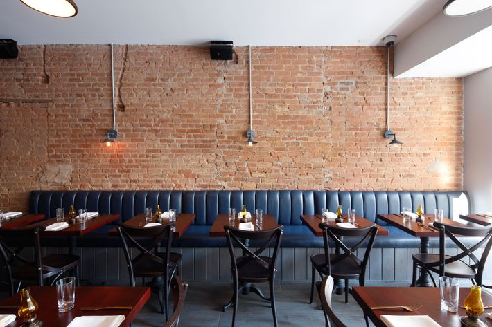 The dark, moody restaurant is bi-level, with a bar on each floor, and it seats 80 altogether.