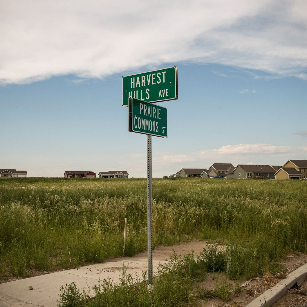 WILLISTON, ND - JULY 24:  Street signs sit in front of empty lots in a new subdivision on July 24, 2013 in Williston, North Dakota. North Dakota is in the midst of a major oil boom, driving the housing market to boom.  (Photo by Andrew Burton/Getty Images)