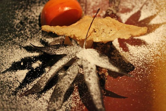 Snow is falling in the form of a maple powder. There's persimmon gelee tucked into the persimmon section, the crisp is actually the skin from the process of tofumaking, flash-fried— and the maple leaves are, in fact, edible (especially with a little help from the sweet maple powder).