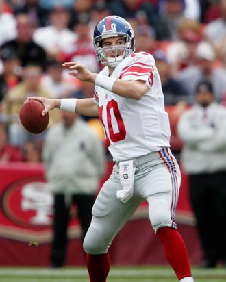 Eli Manning, #10 of the New York Giants prepare to pass the ball during a game against the San Francisco 49ers at Monster Park November 6, 2005 in San Francisco. The Giants defeated the 49ers 24-6.
