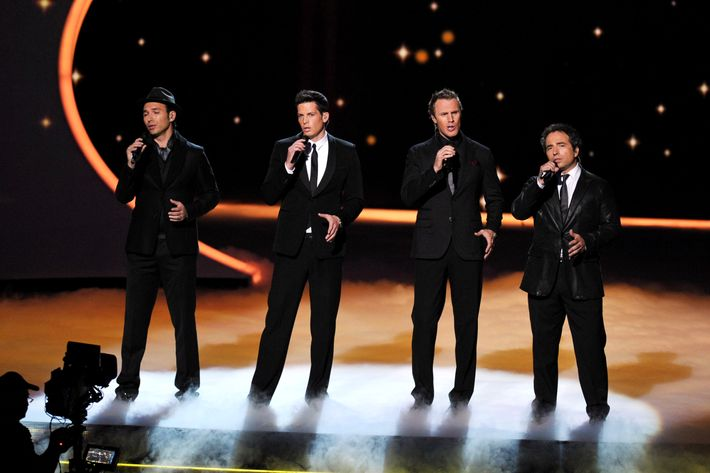 LOS ANGELES, CA - SEPTEMBER 18:  The Canadian Tenors (L-R) Victor Micallef, Clifton Murray, Fraser Walters and Remigio Pereira perform onstage during the 63rd Primetime Emmy Awards at the Nokia Theatre L.A. Live on September 18, 2011 in Los Angeles, United States.  (Photo by John Shearer/WireImage)