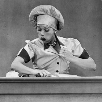 American actresses Vivian Vance (1909 - 1979), as Ethel Mertz, and Lucille Ball (1911 - 1989), as Lucy Ricardo, work side-by side at a candy factory conveyor belt in an episode of the television comedy 'I Love Lucy' entitled 'Job Switching,' Los Angeles, California, May 30, 1952.