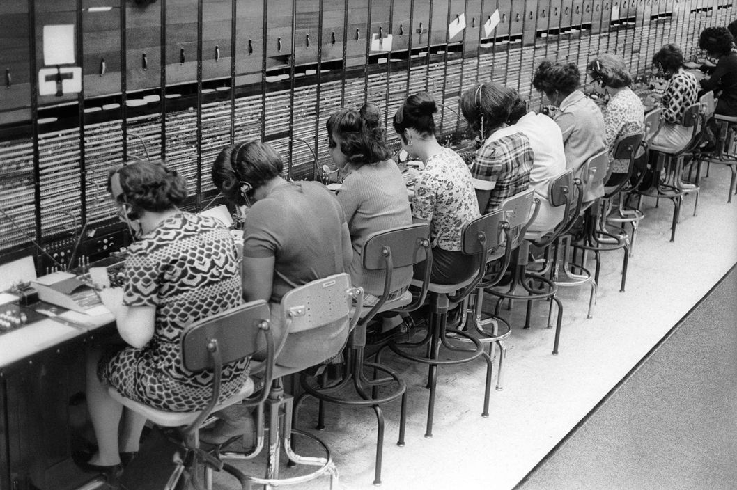 "Brooklyn, New York City, New York / April 14, 1974 The last of the original AT&T switchboard operators, of which 98% were women, as they were believed to be more polite than men. They provided information and helped customers make long-distance calls. The next day the old ""corded"" switchboards were replaced with the more technologically advanced ""TSPS"" system."