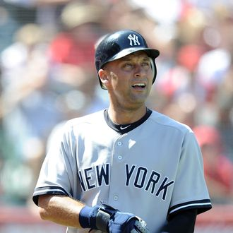 Derek Jeter #2 of the New York Yankees heads to the dugout after scoring a run against the Los Angeles Angels of Anaheim at Angel Stadium of Anaheim on September 11, 2011 in Anaheim, California.