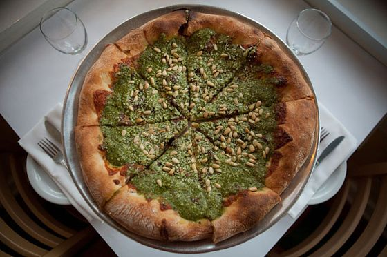 "<b>Pesto Pizza</b>    <a href=""http://sanfrancisco.menupages.com/restaurants/paulines-pizza/"">Pauline's Pizza</a>    <i>San Francisco</i>  Pauline's was a true pioneer in the American New Wave pizza movment, opening over 25 years ago. Their dough remains uniquely yeasty, perfectly crisped from center to edge, with a steaming, fresh-baked-bread interior. This crust becomes a vehicle for everything from seasonal vegetables from one of their two local farms, to housemade chicken sausage or linguisa, to their signature, pleasantly pungent basil pesto and pine nuts."