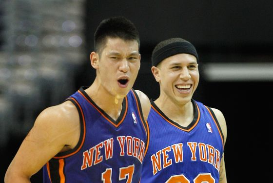 WASHINGTON, DC - FEBRUARY 08: Jeremy Lin #17 of the New York Knicks and Mike Bibby #20 celebrate after Lin scored against the Washington Wizards during the second half at Verizon Center on February 8, 2012 in Washington, DC. NOTE TO USER: User expressly acknowledges and agrees that, by downloading and or using this photograph, User is consenting to the terms and conditions of the Getty Images License Agreement.  (Photo by Rob Carr/Getty Images)