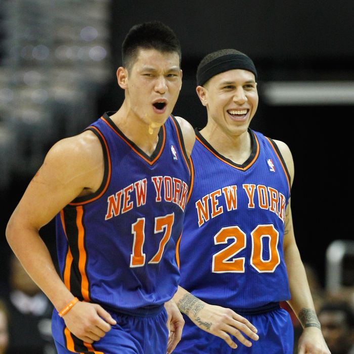 Jeremy Lin #17 of the New York Knicks and Mike Bibby #20 celebrate after Lin scored against the Washington Wizards during the second half at Verizon Center on February 8, 2012 in Washington, DC.
