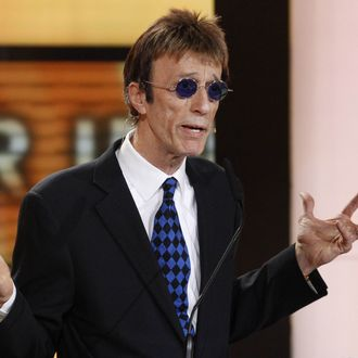British musician Robin Gibb speaks during the awardings of the Goldene Kamera 2011 (golden camera media prize) of the Axel Springer Verlag publishing house on February 5, 2010 in Berlin. AFP PHOTO POOL TOBIAS SCHWARZ (Photo credit should read TOBIAS SCHWARZ/AFP/Getty Images)
