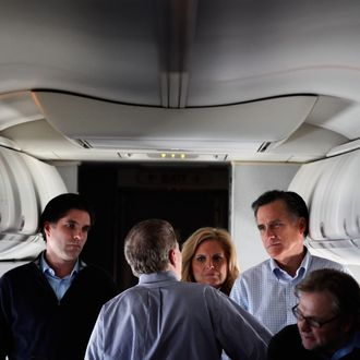 IN FLIGHT - JANUARY 04: Republican presidential candidate and former Massachusetts Governor Mitt Romney (2nd R) talks with (L-R) son Tagg Romney, campaign advisors Stuart Stevens, wife Ann Romney and advisor Eric Fehrnstrom on a chartered airplane after departing Des Moines, Iowa, January 4, 2012 while en route to Manchester, New Hampshire. Romney beat former U.S. Senator Rick Santorum by only eight votes in Tuesday's